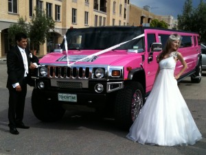 Showtime Limousines Perth beautiful pink limo wedding limousine at a wedding in Fremantle WA