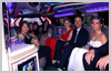 Interior photo of School Ball Perth Limo kids in the Candy Red Hummer before arriving for their entrance at this gala event