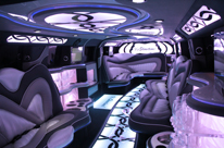 Black Hummer Limo Perth interior, three bars, rgb lights in ceiling, it's showtime! 16 Seater by Showtime Limousines Perth LImo Hire