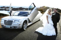 Silver Chrysler wedding cars Perth with bride and groom for a Busselton wedding. Silver Chrysler wedding limo.