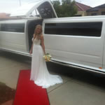 White Hummer Wedding Limousine Perth with dedicated bridal door middle opening jet door