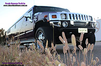 Photo of teh front grille and side of the fancy H200 Hummer Limousine in Midnight Purple