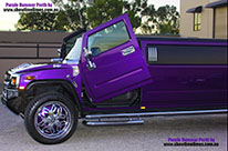 Purple Hummer Stretch Limousine with Lamborghini Doors (Vertical Doors)