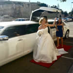Wedding Limo Perth with the Bride exiting the Brand New 2013 White Chrysler 300C Vertical additional Bridal Door Stretch Wedding Limo in Perth City.