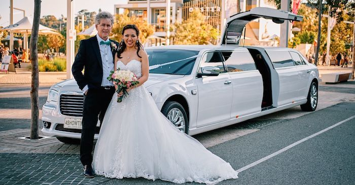 Wedding Limos Perth with bride and groom in the central bridal door white wedding car