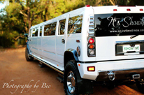 Hummer limo Perth - White Hummer Limousine centrally positioned bridal jet door in middle of limousine